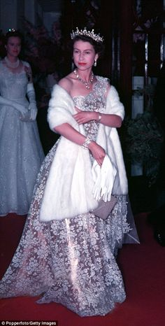 Queen Elizabeth II in high style, her shimmering rose gold one-shoulder gown with floral embroidery, plus a striking tiara and white fur, embodied regal glamour. Hm The Queen, Royal Queen, Her Majesty The Queen, Lady Diana, Royal Fashion, Fashion Photo, High Fashion, 1950s Fashion, Reine Victoria
