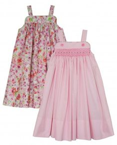 Children's Corner pattern Katina is a girls sundress with narrow straps that button to the front yoke. the smocked or gathered skirt falls from lined and piped yokes. Sizes 1-8 in one package.
