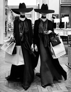 A pair of models leaving a hotel lobby on their way to a photoshoot during the 1992 Which Witch? fashion show in Paris.  This candid gained great publicity in magical society throughout all of Europe; quickly becoming one of the most famous pictures of the decade, and a globally recognized icon of french fashion.  (Yves St. Laurent)