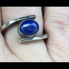 "Vintage Navajo Lapis Lazuli Sterling Silver Ring Vintage Navajo Lapis Lazuli Sterling Silver Ringsigned by Navajo silversmith Ann Curley and stamped ""Sterling"". The lapis lazuli gemstone cabochon is a enchanting deep blue hue with beautiful gold flecks. The design is a captivating modernist style I rarely come across in Native American jewelry so it is not only beautiful but incredible beguiling and unique. An one of a kind vintage treasure✨ Vintage Jewelry Rings"