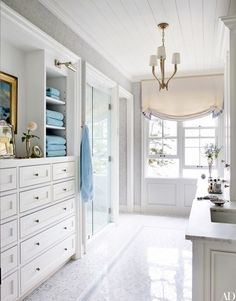 At a Maine compound by designer Suzanne Kasler and architect Les Cole, the master bath boasts custom-made mosaic tile by Waterworks and light fixtures from Circa Lighting   archdigest.com