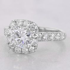 The Bella White Gold Cushion Halo Engagement Ring with 1.50ct Forever One Moissanite