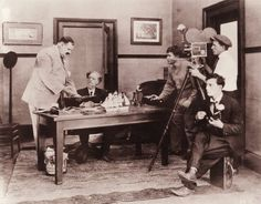 Buster plays ukulele while directing The Haunted House. Via busterkeaton.com Facebook page.