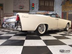 This car scream so much CLASS. 1961 Lincoln Continental Convertible in Sultana White. This car came factory with a ford 385, suicide doors, and a full-sized couch in the backseat. It was even Kennedy's limo