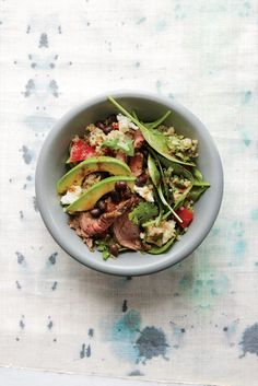 Make dinner in under 30 minutes with this recipe from Cooking Light. Black beans, quinoa, fresh bell peppers and onions are tossed in a tangy vinaigrette then served with chipotle rubbed sirloin st...