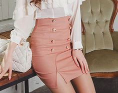 Pink pencil skirt with gold buttons & slit, white blouse