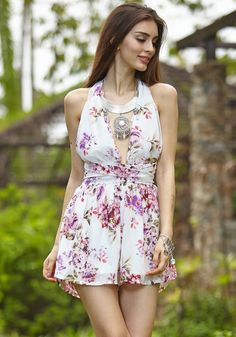 Floral magic romper designed with a plunging V neckline and an open back design which can be styled in various ways. Complete your beach outfit with this and a pair of oversized sunglasses. | Lookbook Store Jumpsuits and Rompers Collection