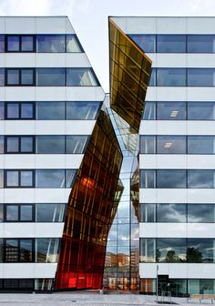 """The Hekla urban quarter, designed by Wingårdhs Arkitekter, won the award Årets Stockholmsbyggnad (Stockholm Building of the Year) in 2010, with the following motivation: """"The 2010 Stockholm Building of the Year award goes to Ericsson's new office building in Kista, where a """"crack"""" in the facade provides a focal point for the entire volume and opens into a light well with unique sculptural qualities."""" []"""