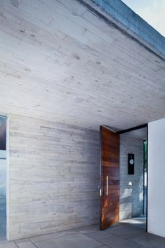 board formed concrete - darren - smooth formed for us - but the contrast with wooden door is awesome