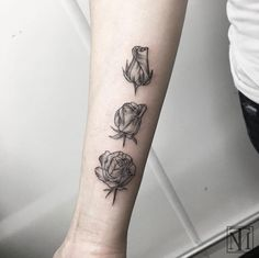 Blossoming rose tattoo by Marlon M Toney