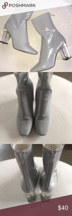 Shiny gray boots with clear heel Fashionable gray boots. Clear heel with wide base so their easy to walk in! Zip up the back. Small scuff on inner toe box as shown in picture. UK size 6 is approximately US 7.5/8. Shoes Heeled Boots