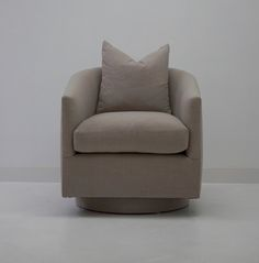 DSC00117.jpgSono Swivel Chair  The Sono swivel chair is built for lounging. Slope arms, down cushion and down back pillow. Swagger.