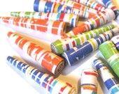 Paper beads by TwistedPlanet on etsy:  http://www.etsy.com/treasury/MTEwMDkyMzh8MTI2NzAxMjM5OA/honey-unique-gifts?ref=pr_treasury