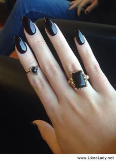black nail polish & rings