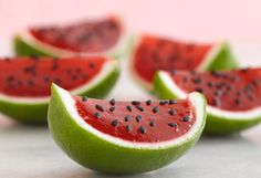 jello watermelons in lime rinds w/ fresh strawberry + black sesame seeds