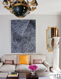 Tino Zervudachi's Artful Paris Apartment: a painting by an Australian Aboriginal artist.  That light.