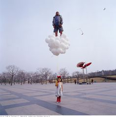 Check out the work of photographer Li Wei. Li is from Beijing, China.    Li is making waves in the art world with these incredible photographs.  He uses mirrors, metal wires, scaffolding, and acrobatics to create his mind-blowing images.