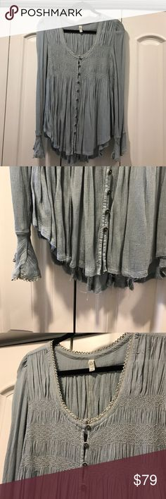NWOT Free People long sleeve button up top This top is so soft and fun! It's a really pretty sea foam green/soft teal color. Tags were removed but this top has never been worn. Perfect/new condition! Top is frayed along the bottom but this is how it came, it's just part of the style;) Free People Tops Button Down Shirts