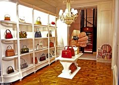 Showroom: A real hand shows the scale of the tiny, designer-label replica handbags
