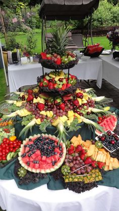 Ultimate fruit platter bar & provide skewers for guests to make their own fruit sticks