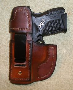 """This is the idea of what I make for whatever pistol you want. This is the XDS example. The 1 clip version """"clip-on"""" rides better for smaller pistols because the weight / size is more proportionate to the size of the gun therefore does not flop around. I also offer a 2 clip version (one … Xds 45 Holster, Holsters, Leather Projects, Leather Working, Leather Craft, Hand Guns, Jackson, Jacket Men, Leather Jacket"""