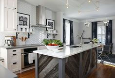 Rustic reclaimed barn wood kitchen island with marble counter