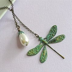 This is stunning in its simplicity: Dragonfly Lariat Necklace - Verdigris Brass - http://www.artfire.com/ext/shop/product_view/3675686#