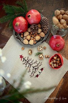 pomegranate and evergreen sprig, plus nuts - simple natural centerpiece