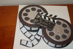 Cinema inspired birthday cake by SweetUnique, via Flickr