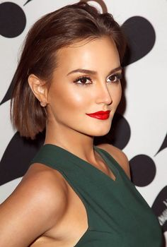Leighton; nice color combination with bright red lips and forest green dress.