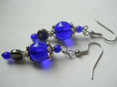 This pair of beaded earrings combines bold blend of Bohemian style meets 1930s glamour in rich shades of blue and silver.  #earrings #etsy #glamour #highstyle #couture #bohemian #designer #artisan #bridaljewelry #bridalearrings #fashion #Czechglass #royalblue #blue #dangle #earring #hypoallergenic #handmade #1930s #vintage #inspired #chicago #antiqued #unique #accessories #womensfashion by chicagolandia, $18.00