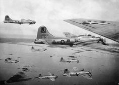 B-17s of the 390th Bomb Group, flying out of RAF Framingham, England, between 1943-45
