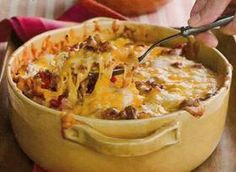 This is a flavorful casserole, made with ground beef, Cheddar cheese, seasoned veggies, cream cheese, sour cream, and egg noodles.