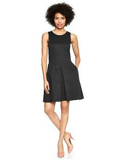 Sleeveless sateen fit  flare dress  Standard fit hits me at the knee, actually has enough room in the bust.