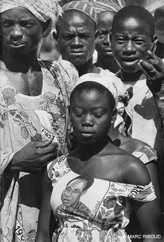 On 6 March 1960 in Accra, capital of Ghana: Independence Day. The effigy of Kwame N'Krumah is printed on dresses and tunics. - Photographed by Marc Riboud