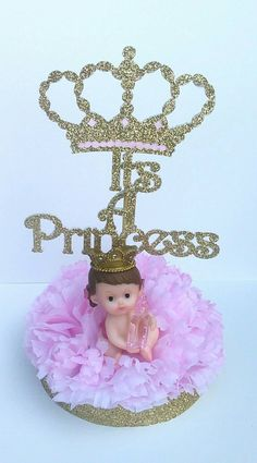 These gorgeous centerpieces are perfect for welcoming your little Princess!  »Each centerpiece is approximately 8 inches high and about 6 inches wide (with sign and figurine) «  »This listing is for 1 royal centerpieces. Each will include: a pink flower base (as seen in photo), a baby girl figurine and a Its A Princess sign  **The Its A Princess sign will be packed separately to avoid damage during shipping.  »» Assembly «« The base is Styrofoam and can easily be penetrated by the sign…