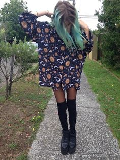 Sun and moon print is very 90s and very grunge. We love the thigh high socks with this outfit.