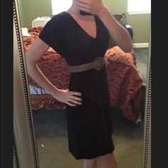 Black jersey v neck dress. Perfect transition dress for fall with boots and scarf. Belt not included Dresses