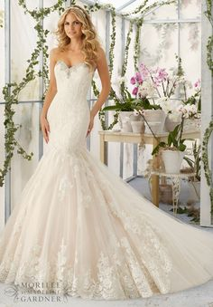 """Wedding Dresses and Wedding Gowns by Morilee featuring Crystal Beaded Embroidery Meets the Cascading Alencon Lace Appliques and Scalloped Hemline Edging the Tulle Train Inset Available in Three Lengths: 55"""", 58"""", 61"""". Colors Available: White/Silver, Ivory/Silver, Light Gold/Silver."""
