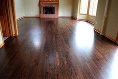 Naperville Hardwood Floor Refinishing Photos - We stained the floors a custom blend of 50% Ebony and 50% Sedona Red and then finished them with commercial grade water-based finish in a satin sheen.