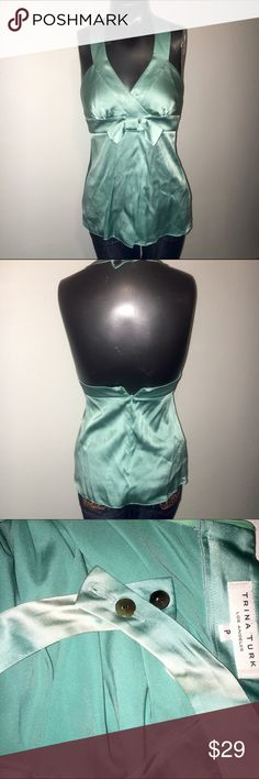 "Trina Turk Halter Top Bow & Button Detail Silk Top V-Neckline Sleeveless Teal Solid Dry clean only Measurements 28"" Chest, 16"" Length Materials 93% Silk, 7% Spandex *Size P is Petite which Equal a XS/S. Trina Turk Tops Blouses"