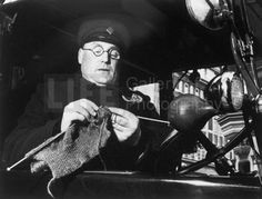 Taxi driver knitting for the war effort, circa 1939