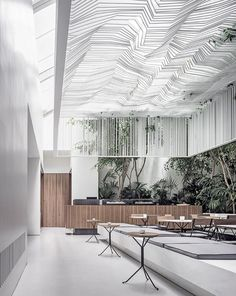 kois associated architects hang sculptural ceiling canopy over museum café in athens housed within the museum of cycladic art in athens, the clean and all-white interior has been created to reflect the artwork showcased in the museum. Canopy Bedroom, Canopy Tent, Hotel Canopy, Fabric Canopy, Tree Canopy, Interior Design Magazine, Commercial Design, Commercial Interiors, Contemporary Architecture
