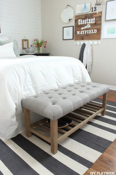 Add a tufted bench at the bottom of your bed to give your bedroom a more complete look. Bonus points...it's a great place to sit and put your shoes on each morning.