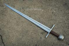 "13th C. Templar Sword  Overall Length 36.8"" Blade Length 30"" Grip Length 4.1"" Blade Width 2"""