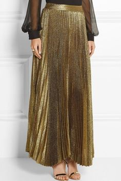 - This maxi skirt takes glam to an all new level. With its high-shine metallic foil finish & accordion pleats you are sure to rule elegance. - Runs true to US Sizing - Textured, full length skirt - re