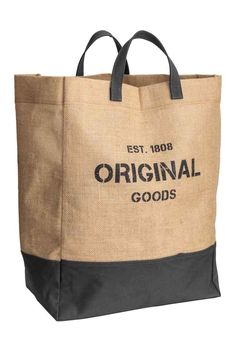 5ddff6018f Laundry basket in jute with two handles and a lower section in contrasting  colour cotton twill. The basket has a text print. mokeefe · Bags