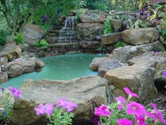 This small water feature was built next to a patio. It has a tropical feel and beautiful sound.