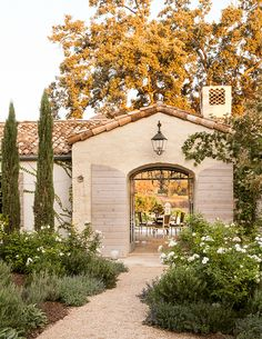 Steve and Brooke Giannetti—he's an architect, she's a decorator—made the decision a few years ago to leave the bustle of Los Angeles for a more rural setting.  In the best of California living, outdoor spaces blend seamlessly with interiors. Lantern, Troy Lighting.    - Veranda.com #patinafarm #giannettihome