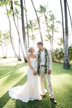 Tropical wedding attire, strapless lace wedding dress, tan groom suit, maile lei, Hawaii // Makai Creative